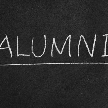 """""""Alumni"""" written on chalkboard"""